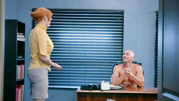 Plump ginger secretary Lauren Phillips pleasures her big boss on his desk