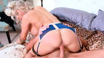 Tattooed blonde Alyssa Lynn fucks the young guy cowgirl style on the broad bed